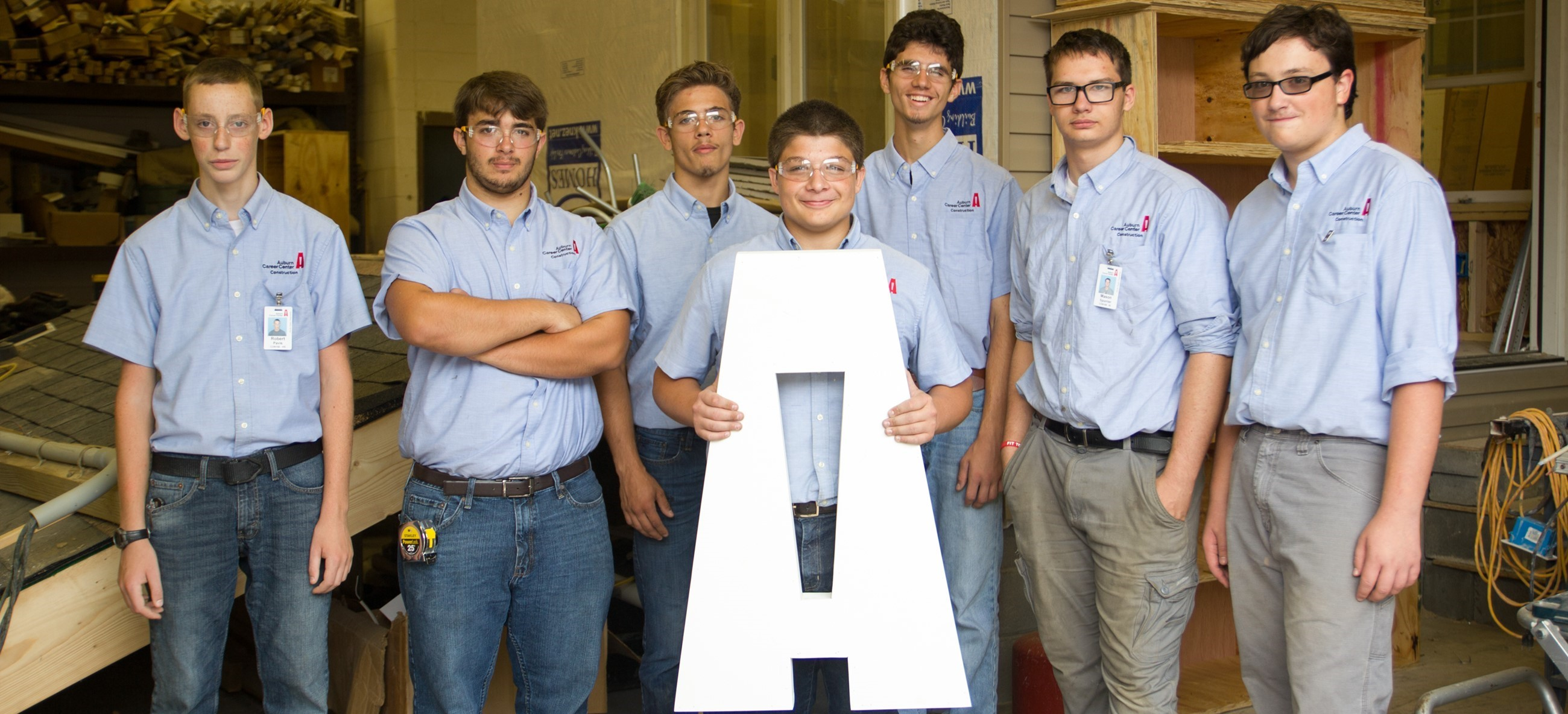 Construction Students Holding Logo A Project