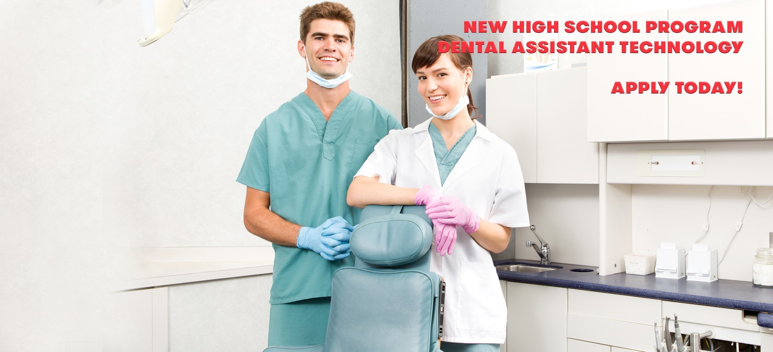 male and female standing with scrubs by a dental chair in dental office