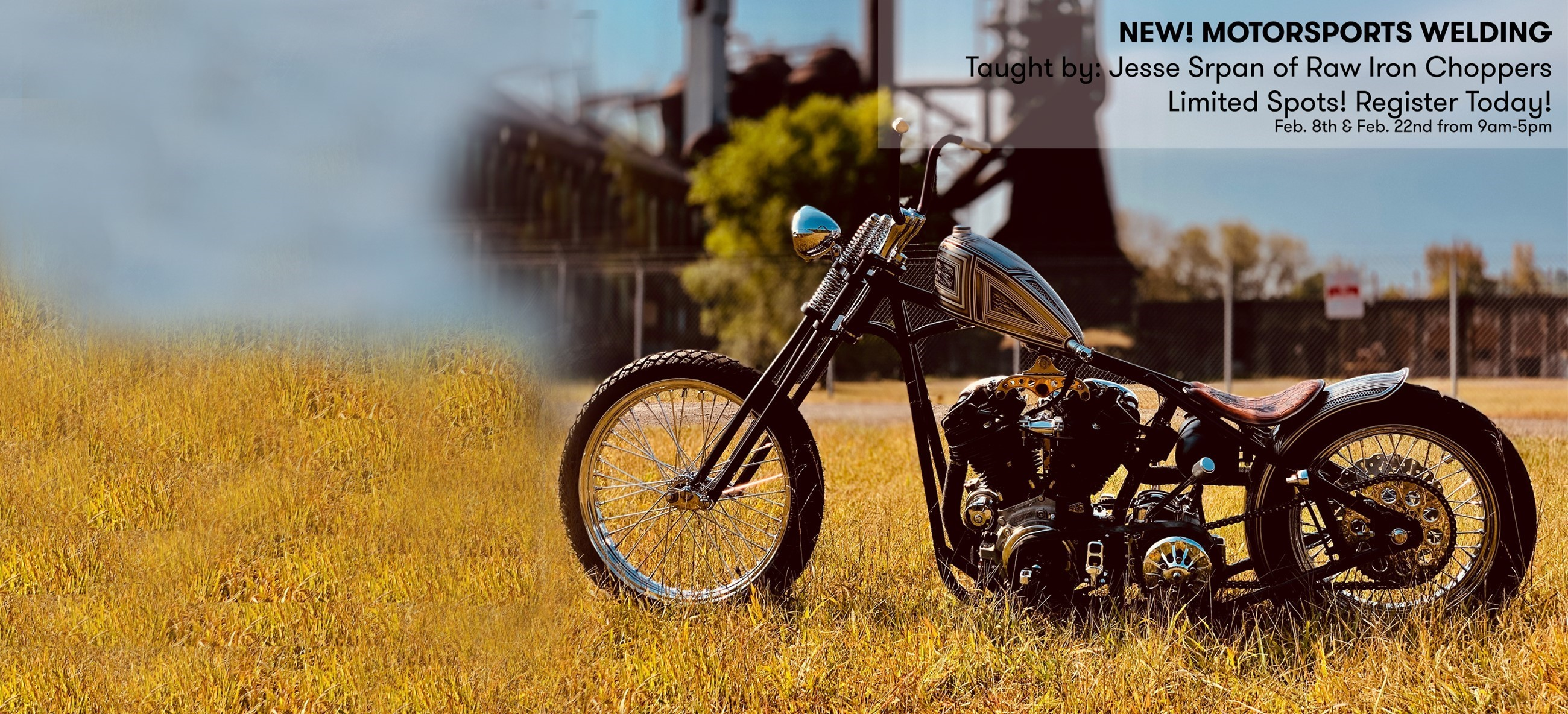 Motorcycle in a field with a structure in the background