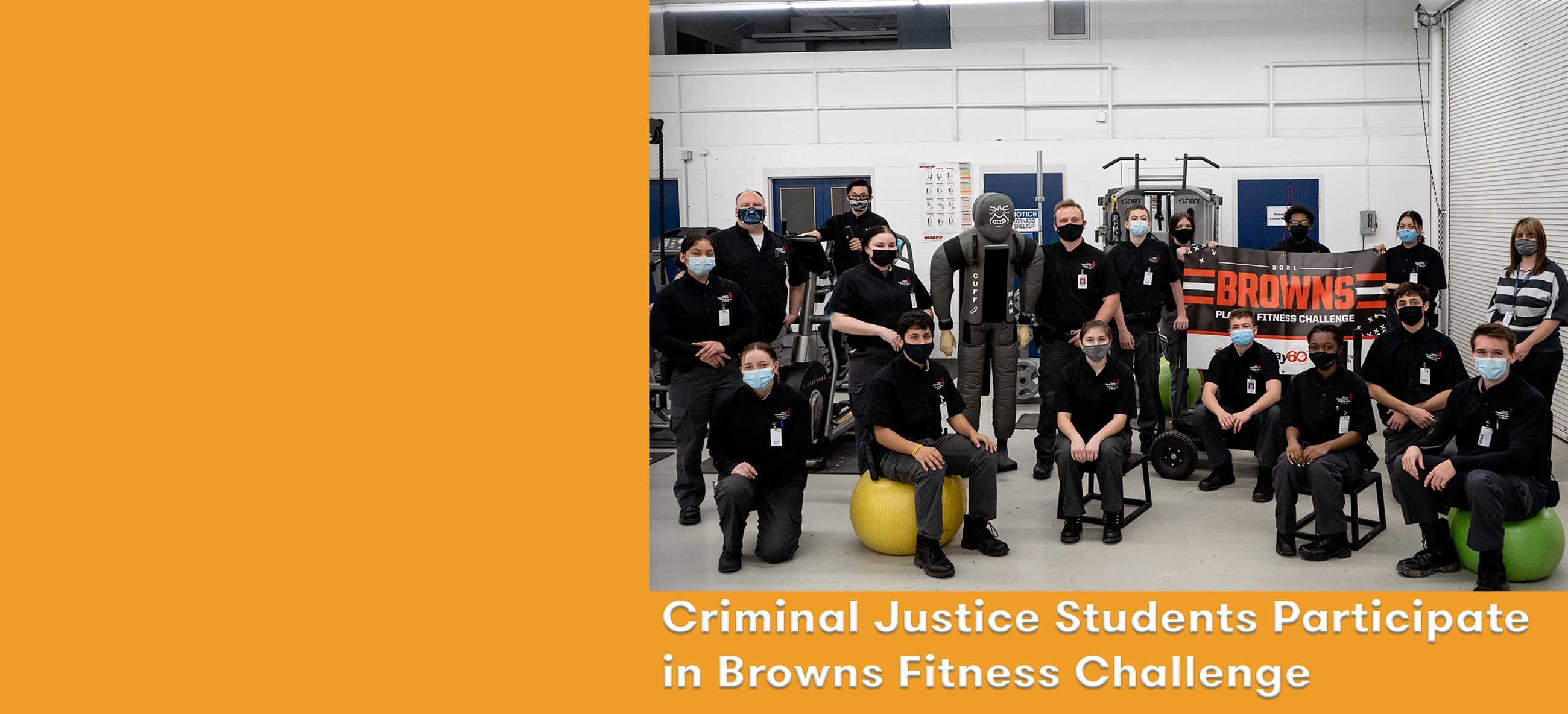 students in uniform standing and sitting on exercise equipment with Browns banner