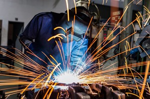 person welding with sparks flying
