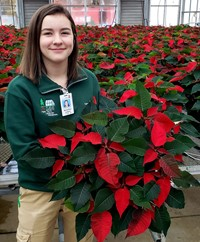 student holding a poinsettia